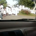 People queuing outside Doctor's Office on Grand Bahama dressed in white Sunday morning