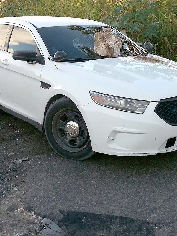 Police cruiser destroyed after police attempted to arrest a suspect and shot him fatally.