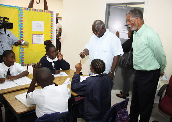 DPM Phillip 'Brave' Davis and BTC CEO Leon Davis visit the students of Rum Cay School in their make shift classes in the BTC offices.