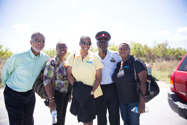 BTC CEO Leon Williams, CMO Janet Johnson, VP of Customer Operations Patricia Walters and VP of Human Resources Valerie Wallace are escorted by a Rum Cay based Royal Bahamas Police Officer on their visit.
