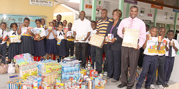 Students of the Eva Hilton Primary School donated an assortment of items towards the Hurricane Joaquin Relief effort during a special assembly on Friday, October 16, 2015 at the school in Oakes Field. Pictured amongs the Grade 5 students, and teacher Brenda Thompson, are Howard Newbold, Superintendent, Northwestern District, Ministry of Education, Science & Technology; Rovan Carey Sr., PTA President; Chrystal Glinton, First Assistant Secretary, NEMA and Jermaine Butler, Principal.  (BIS Photo/Patrick Hanna)