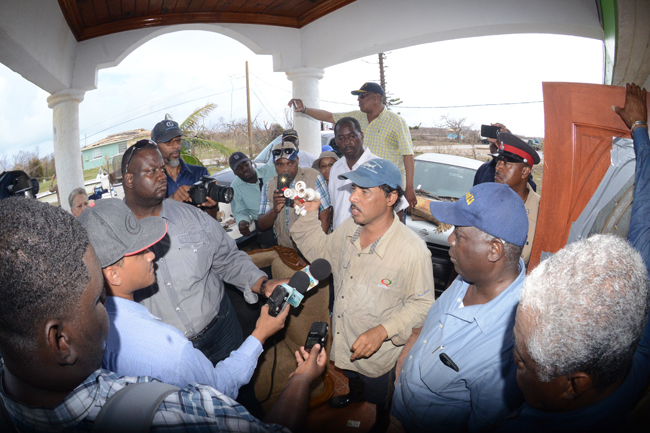 Michael Carroll of Landrail Point recalls the hurricane as DPM. Davis and Minister B.J. Nottage