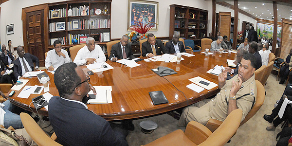 Prime Minister the Rt. Hon. Perry Christie (centre right), with Cabinet Ministers and key Government Agencies, monitors the effects of Category 4 Hurricane Joaquin on the Bahama Islands, and coordinates response at the Office of the Prime Minister on October 2, 2015.  After the all-clear from NEMA, assessment of the aftermath of this very dangerous storm will get underway.  (BIS Photo/Peter Ramsay)