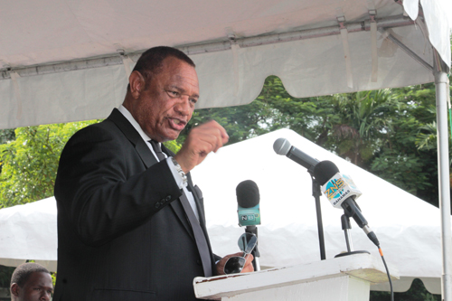 Prime Minister and Minister of Finance the Rt. Hon. Perry Christie speaks during a National Heroes Day Ceremony, on October 12, 2015, at the Botanical Gardens. (BIS Photo/Eric Rose)
