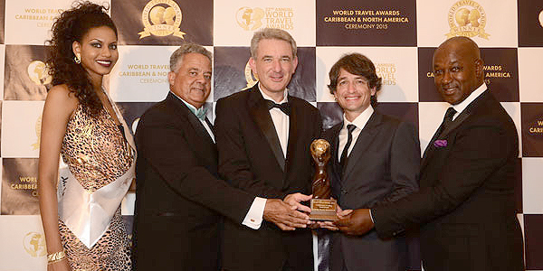 (From left to right: World Travel Awards model, Gary Williams, General Manager of Sandals Royal Bahamian Spa Resort & Offshore Island , Jeremy Mutton, General Manager of Sandals Emerald Baya Spa Golf, Tennis & Spa Resort, Ramel Sobrino, General Manager of Sandals Ochi Beach Resort and David Latchimy, General Manager of Sandals Negril Beach Resort & Spa)