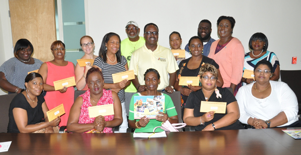 JUNIOR GROUPS RECEIVE FUNDING - Members of the Junior Junkanoo groups received their seed money on Saturday during a cheque presentation at the Ministry of Youth, Sports and Culture in Freeport.  Shown along with the Minister responsible for Youth, Sports and Culture, Dr. the Hon. Daniel Johnson, centre, are: Monique Leary, Ministry of Youth, Sports and Culture, seated at left; and standing second from left, Chevita Campbell, Chief Councilor for the City of Freeport Council. (BIS Photo/Vandyke Hepburn)