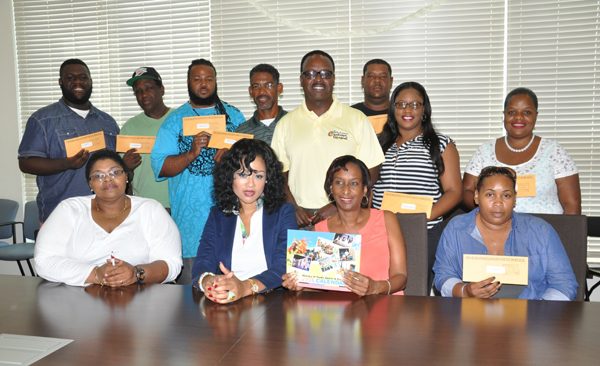 SENIOR GROUPS RECEIVE FUNDING - Senior Junkanoo groups received their seed money on Saturday during a cheque presentation at the Ministry of Youth, Sports and Culture. Dr. the Hon. Daniel Johnson, the Minister responsible was on hand to meet with the various groups and organizations involved. Minister Johnson (standing centre) is seen with Junkanoo group members along with members of the Grand Bahama Junkanoo Committee. (BIS Photo/Vandyke Hepburn)