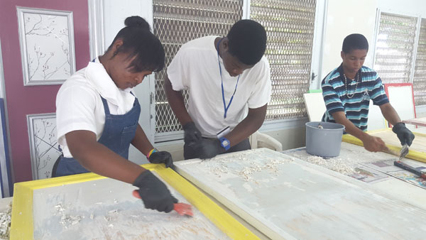 SURFACE PREPARATION - C. I. Gibson seniors, Shaquelle Taylor, Fabian Shepherd and Marchario McDonald are hard at work preparing surfaces for painting. The students attend BTVI twice per week as part of a dual enrollment program.
