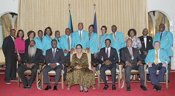 Minister of Youth, Sports and Culture the Hon. Dr. Daniel Johnson (second from left) and Her Excellency Dame Marguerite Pindling, Governor General, centre, are pictured with the National Sports Hall of Fame Class of 2015 honourees, and their representatives, at Government House during the Induction Ceremony. (BIS Photo/Raymond A. Bethel, Sr.)