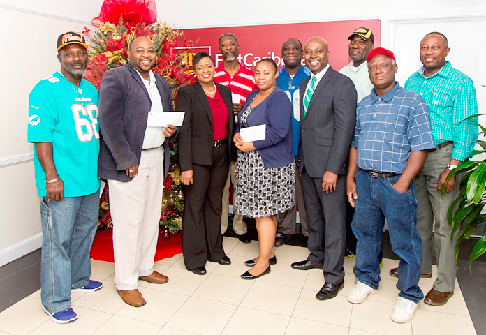 "L-R – Front Row: Kimsley Ferguson, Coordinator, Body of Christ; Glen Knowles, Chairman, Fancy Dancers; Beulah Arthur, CIBC FirstCaribbean Country Treasurer; Christina ""Muffin"" Fernander, Vice Chair, One Family; Sean Blyden, CIBC FirstCaribbean Shirley Street Branch Manager; Eric Knowles, Chairman, Prodigal Sons. Back Row: Wellington Henfield, Chairman, Redland Soldiers; Henry Higgins, Leader, Conquerors for Christ; Toby Austin, Chairman, Saxons; Winston Rolle, Chairman, Music Makers."