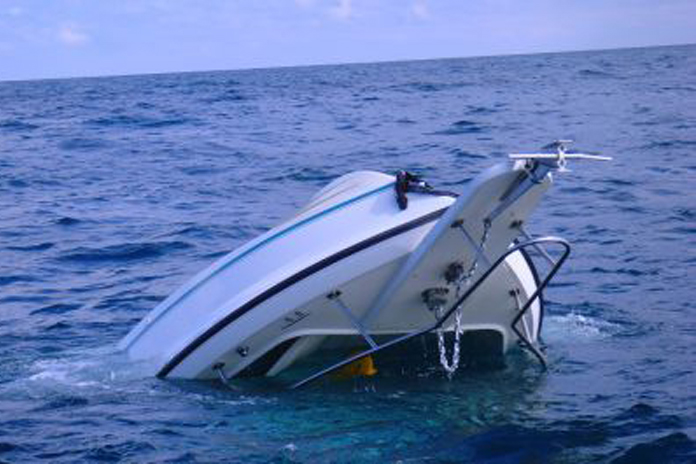 the capsized 21' Pursuit off Holland