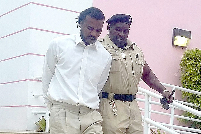 Kenneth George Hart being escorted out of court today by police. Photo by tribune242.com