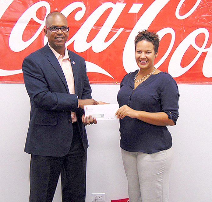 Photo (L-R) Dwayne Swaby, VP of Development - Sunshine Insurance, and Cara Douglas, Marketing Manager - Caribbean Bottling Company. Over the past four consecutive years CBC has donated a total of $20,000 to Marathon Bahamas.