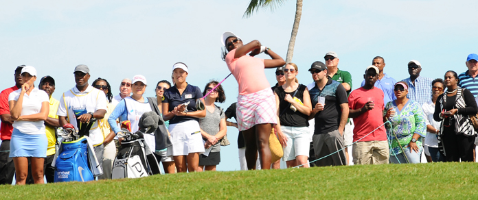 Bahamian golfer Georgette Rolle teeing off Thursday morning to a swelling crowd, in the qualifying round of the Pure Silk-Bahamas LPGA Classic at the Ocean Club Golf Course, Paradise Island, January 25-31, 2016.  (BIS photo/Kemuel Stubbs)