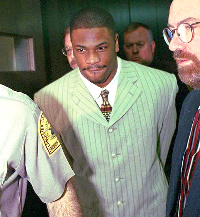 Lawrence Phillips leaves Lancaster County Court in Lincoln, Neb., in 1997 to begin a 30-day sentence for a probation violation. Dennis Grundman / AP