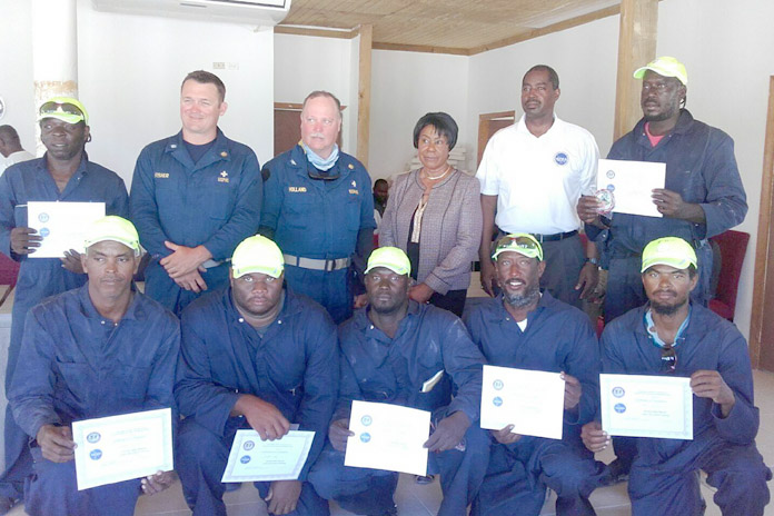 The National Emergency Management Agency (NEMA) in partnership with the United States Northern Command (USNORTHCOM) and the United States Public Health Services trained 12 individuals in water rescue techniques held May 9-12, 2016. The course participants were:  Anthon Miller, Royal Bahamas Police Force; Devaughn Newry, Royal Bahamas Police Force, Darrel Moss, Department of Environmental Health Services; Edward Ferguson, Department of Environmental Health Services; Thomas Thompson, driver; Oniel Gilbert, Romeiko Burrows, Royal Bahamas Defence Force; Rueben Ferguson, Department of Environmental Health Services; Kenneth Scavella, Bonefish Guide; and Derick Ingraham, Fisherman. Pictured amongst them are Commander Kiel Fisher, US Department of Health and Human Services; Captain John Holland, US Department of Health and Human Services; Family Island Administrator Francita Neely; and Captain Stephen Russell, Director, NEMA.