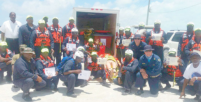 Participants and facilitators pose for a photo at the completion of a Surface Water Rescue Course in Acklins at the Spring Point community centre and surrounding sea, June 20 - 23, 2016. Pictured amongst the participants are Captain John Holland, U.S. Department of Public Health Services; Jeffrey Smith, USNORTHCOM/U.S. Embassy, Nassau; Captain Stephen Russell, Director, NEMA; Police Inspector A. Miller, District Police Chief; and Captain Doug Ebert – U.S. Department of Public Health Services and Luke Bethel, training officer, NEMA.  (BIS Photo/Lindsay Thompson)