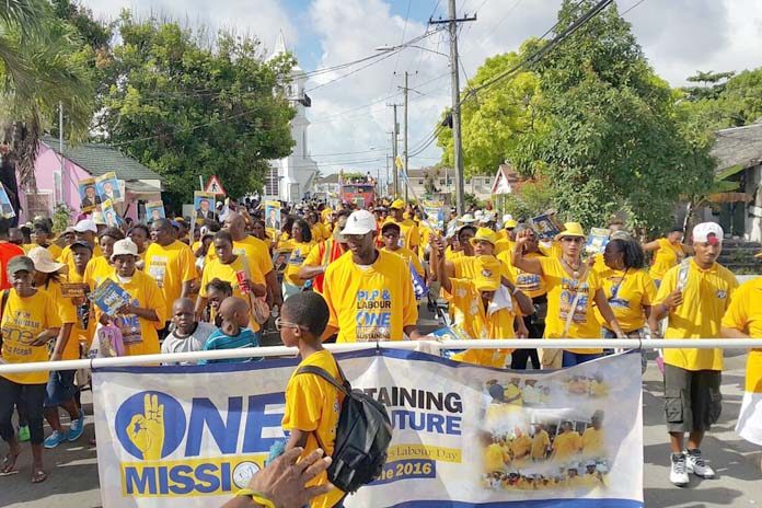 GOLD RUSH! Thousands of PLP supporters marched with labour on Friday.