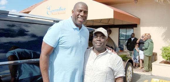 Davis meets with world basket ball icon Magic Johnson.