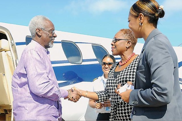 [2012} Digicel rep PJ Patterson lands in the Bahamas -  DO THEY BELIIEVE IN BAHAMIANS?  photo by the Nassau Guardian