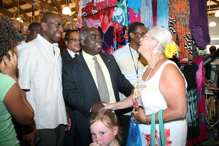 Deputy Prime Minister and Minister of Works and Urban Development the Hon. Philip Davis greets a visitor who is shopping in the straw market. (BIS Photo/Raymond Bethel)