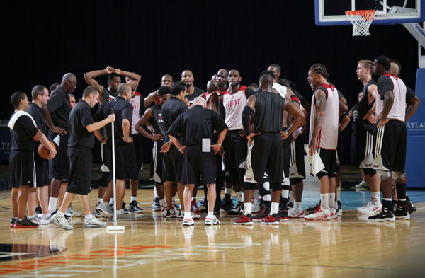 The Miami Heat huddles on court during pre-season training camp at the Atlantis, Paradise Island on Tuesday, October 1, 2013. The team arrived Monday, September 30; the camp ends October 3.