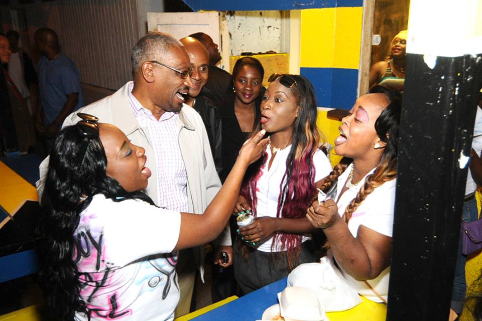 Scores of young people turned excited as Minnis entered Potter's Cay.