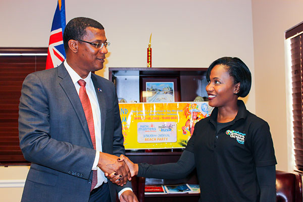 Turks and Caicos Islands Premier; Hon Dr Rufus Ewing shakes the hand of Ginger Moxey- President & CEO, Immerse Bahamas , representing the Grand Bahama Cultural Carnival Company in agreement to attend upcoming Bahamas Junkanoo Carnival, in Grand Bahama in April.