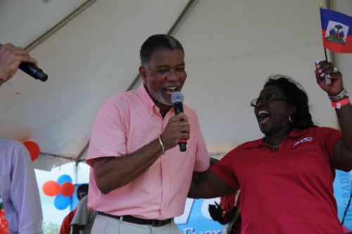 BTC CEO Leon Williams and Chief Marketing Officer Janet Brown all ready to celebrate at Haitian Flag Day. BTC was the title sponsor of the celebratory event.