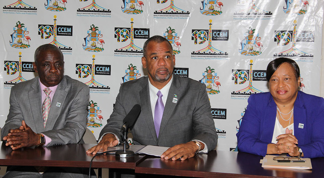 The Hon. Jerome Fitzgerald, Minister of Education, Science and Technology, (centre) is pictured along with Lionel Sands, Director of Education (left) and Donella Bodie, Permanent Secretary. (BIS photo/Letisha Henderson)
