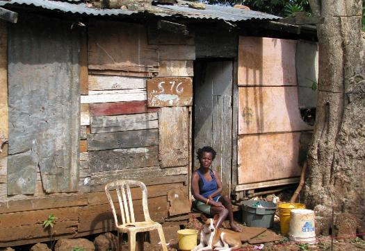 A mother in the Exchange District near Ocho Rios Jamaica with no portable water or sanitary conveniences.