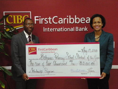 Marie Rodland-Allen, Managing Director of CIBC FirstCaribbean presents a donation to Bahamas Primary School Student of the Year Foundation President and Founder Ricardo Deveaux. CIBC FirstCaribbean has sponsored a scholarship in the program for 13 consecutive years.