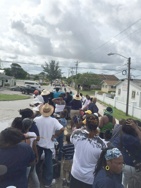 Hundreds march and road behind Prime Minister Rt. Hon. Perry Christie on Grand Bahama at the Labour Day events on that island Friday.