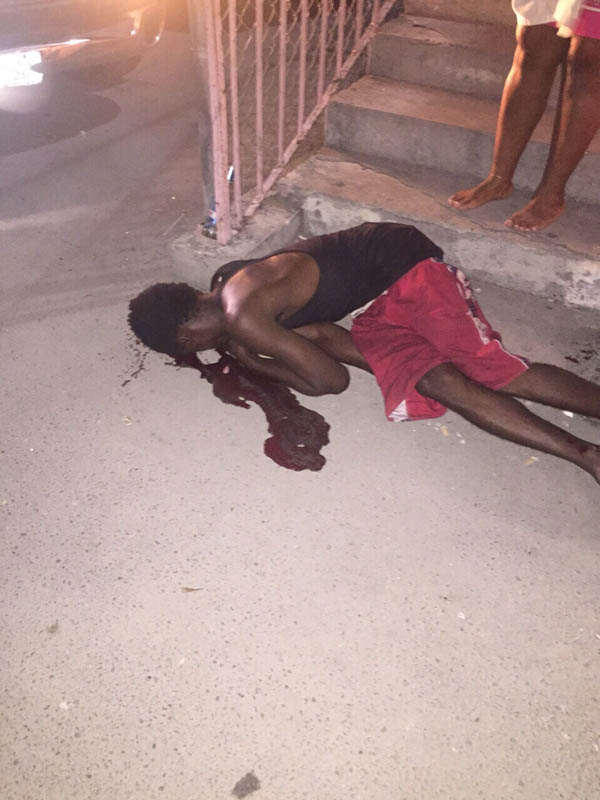 Victim on the ground motionless at the country's latest homicide!