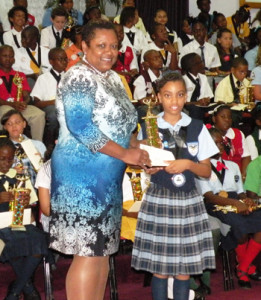 Kaitlyn Francis receiving her awards from Mrs. Tabitha Newbold, CIBC FirstCaribbean Branch Manager, Marathon Mall Branch
