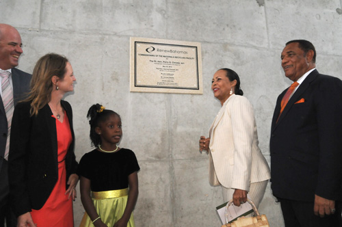 Prime Minister the Right Hon. Perry G. Christie unveils the plaque officially opening the Renew Bahamas Materials Recycling Facility, the Government-owned compound on Harold Road. The ceremony was held on the site on Thursday, May 28. Pictured L-R: President and CEO, Renew Bahamas, Mr. Gerhard Beukes and Mrs. Beukes; Mrs. Bernadette Christie and Prime Minister Christie. (BIS Photo/Peter Ramsay)