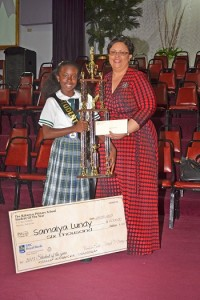 Mrs. Deborah Zonicle, RBC Royal Bank of Canada, Manager of Product Channels and Marketing, The Bahamas, Turks & Caicos Island and Cayman presenting Samaiya Lundy with her $6,000.00 Scholarship for high school