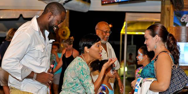 RAISING AWARENESS - Save The Bays CEO Vanessa Haley-Benjamin (second from left) talks to attendees about the need to preserve the environment for future generations. We at BP hopes someone quickly JAIL this crew seeking to destablize the Bahamas for people in Lyford CAY!