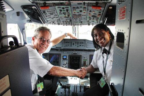 Captain Paul DaSilva (left) and First Officer Karen Tulloch in the flight deck at V.C. Bird International Airport.