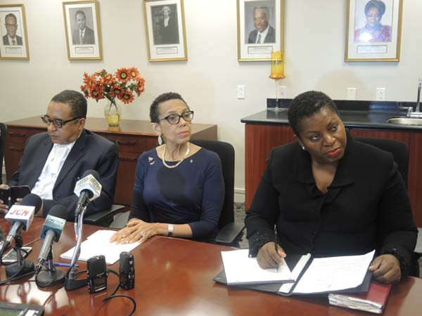 Attorney General and Minister of Legal Affairs, the Hon. Allyson Maynard-Gibson, center, is pictured answering questions from the media during a press conference at the Ministry of Legal Affairs on Thursday afternoon. The Minister put forth the policy of the government of The Bahamas regarding the Baha Mar bankruptcy filing on the 29th June 2015 in a Delaware court. To her left is the State Minister for Legal Affairs, the Hon. Damian Gomez and to her right is the Director of Legal Affairs, Ms. Antoinette Bonamy.