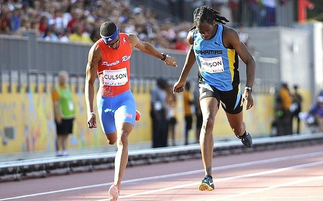 Jeffery Gibson, right, and Puerto Rico's Javier Culson cross the line in the men's 400 meter hurdles final at the Pan Am Games. (AP Photo)