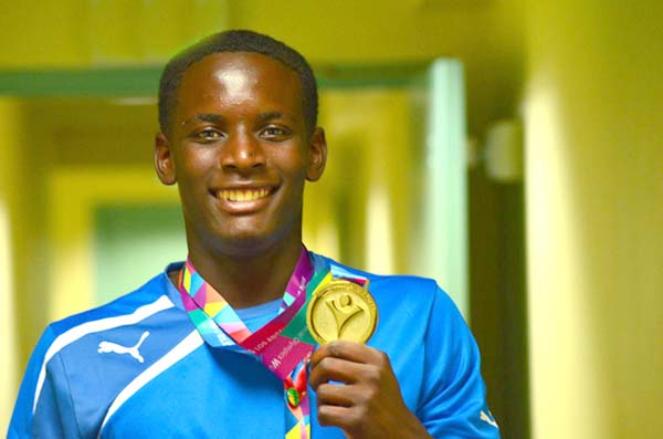 Special Olympics Athlete Cornel McClain celebrated his birthday 1 day early by turning in a GOLD MEDAL performance in the 100m backstroke (male 16-21) at the 2015 Special Olympics World Summer Games. Cornel got the ball rolling by picking up the first medal of these games for Team Bahamas. (Photo: Bahamas Special Olympics)