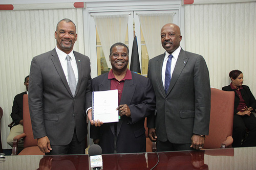 The Hon. Jerome Fitzgerald, Minister of Education, Science and Technology (left) is pictured along with the Hon. Shane Gibson, Minister of Labour and National Insurance (right) and Charles Wildgoose, president of the Bahamas Education and Managerial Union following the signing of the first Industrial Agreement. (BIS Photo/Raymond A. Bethel, Sr.)