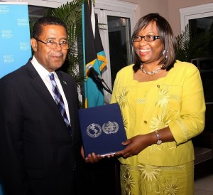 Minister of Health the Hon. Dr. Perry Gomez accepts national award from PAHO/WHO Director Dr. Carissa Etienne, celebrating the Elimination of Measles in the Region of the Americas. (BIS Photo/Patrick Hanna)