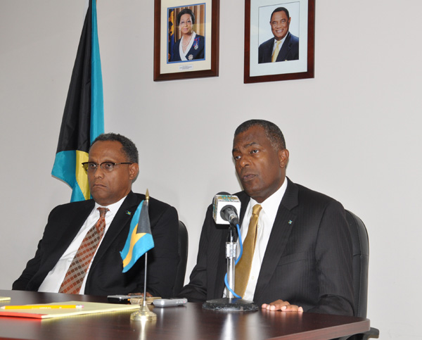 PASSPORT FEES - Minister of Foreign Affairs and Immigration, the Hon. Fred Mitchell clarified for residents of Grand Bahama on Friday that the fee for a passport remains at $50. If a passport is required in 48 hours, there is a fee of $200 that can be paid. Shown from left are: Minister for Grand Bahama, the Hon. Dr. Michael Darville and Minister Mitchell.  (BIS Photo/Andrew Miller)