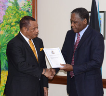 Dr. Marcus Bethel presents to Prime Minister Report on Hawksbill Creek Agreement.
