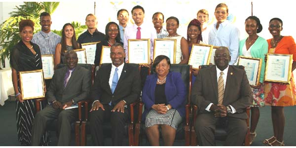 The All-Bahamas Merit Scholarship Awards Ceremony was held at the Thomas A Robinson National Stadium conference room on Wednesday, August 12, 2015. Pictured from left are Lionel Sands, Director of Education; the Hon. Jerome Fitzgerald, Minister of Education, Science and Technology; Donella Bodie, Permanent Secretary; and Reginald Saunders, Administrator Scholarships and Loan Division, Ministry of Education, Science and Technology. Pictured back row are All-Bahamas Merit Scholars and National Merit Scholars. (BIS Photo/Patrick Hanna)