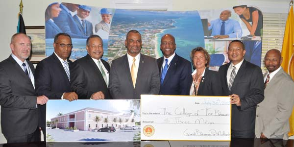 GBPA DONATES MONEY FOR DORMS - The Grand Bahama Port Authority on Thursday donated $3M for the construction of dorms and a multi-purpose facility for The College of The Bahamas Northern Campus. Shown from left during the presentation are: Mr. David Rulien, Sales Manager, US and Caribbean, ALMACO Construction; Dr. Michael Darville, Minister for Grand Bahama; Dr. Rodney Smith, president of The College of The Bahamas; Jerome Fitzgerald, Minister of Education, Science and Technology; Alfred Sears, chairman of COB Council; Sarah St. George, vice-chairman, Grand Bahama Port Authority; Ian Rolle, president, Grand Bahama Port Authority; and Alfred Jones, COB Council member and vice- president of Building and Development Services, GBPA.  (BIS Photo/Vandyke Hepburn)