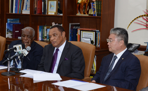 Pictured during the signing ceremony at the Office of the Prime Minister on Wednesday, July 29, 2015 are from left: Godfrey Eneas, President of BAMSI; Prime Minister Christie; and Yu Zhigang, President of Ocean University of China. (BIS Photo/Peter Ramsay)