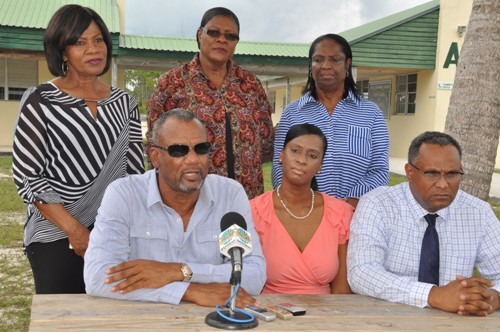 CLASSROOMS READY – Minister of Education Science and Technology the Hon. Jerome Fitzgerald is pictured during a press briefing at the Sir Jack Hayward Junior High School on Friday. He said he was impressed with the work being done in preparation for the 2015/2016 academic year. Left to right seated are: Mr. Fitzgerald; Shennan Rolle, Principal of the Sir Jack Hayward Secondary School and Dr. Michael Darville, Minister for Grand Bahama. Standing left to right are: Dorothy Kemp, District Superintendent for East Grand Bahama; Mary Russell, District Education Officer, East Grand Bahama; and Mary Cooper, District Superintendent, West Grand Bahama. (BIS Photo/Andrew Miller)